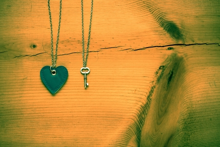 Vintage Valentine,   heart and key on rustic grunge  cracked wood for Valentines day background photo