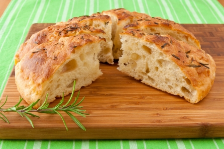 Homemade round Italian rosemary Focaccia bread sliced  photo