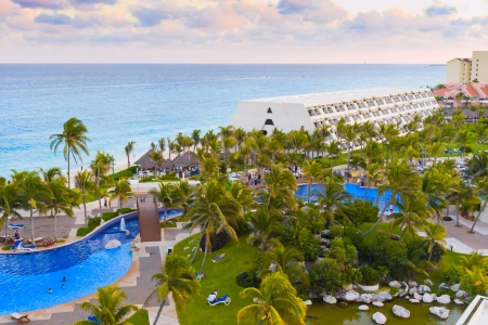 Luxurious hotel with a swimming pool at evening in Cancun, Mexico