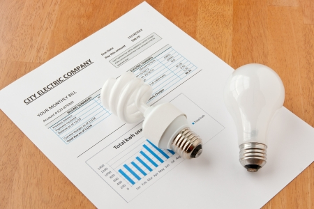 Energy efficient and incandescent  bulbs on electric bill  Energy efficient house concept Stock Photo - 17990829