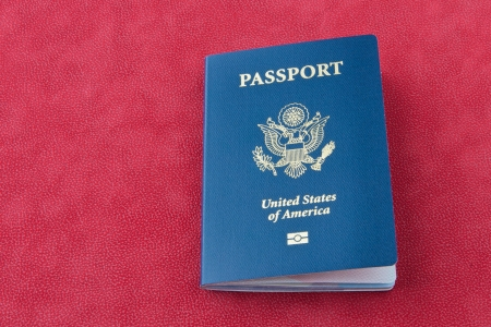 American passport  on red background
