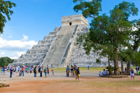 archaeological sites: CHICHEN ITZA, MEXICO - DECEMBER 26: Tourists visiting Chichen Itza, one of the most visited archaeological sites in Mexico on December 26, 2007. About  1.2 million tourists visit the Mayan ruins every year.