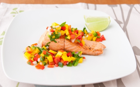 Salmon fillet with mango salsa, healthy eating  selective focus
