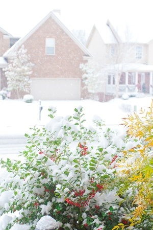 frontyard: Snowfall on a street in an american town, view from front porch  shallow dof