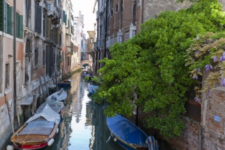 The narrow street - channel in Venice, Italy