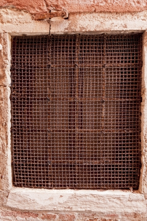 i net: Old rustic mesh window screen on the wall in Venice, Italy Stock Photo