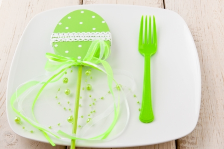Easter place setting with decorated egg photo