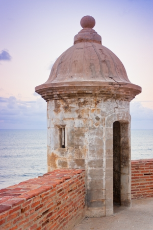 puerto rico: Lookout tower at El Morro Castle fort in old San Juan, Puerto Rico at sunset. Stock Photo