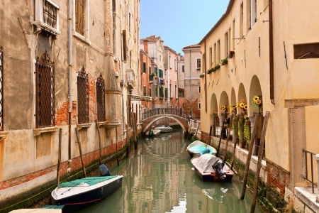 The narrow street - channel in Venice, Italy in warm tones  photo