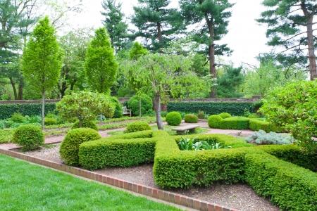Fresh green landscape of formal garden  at spring  photo