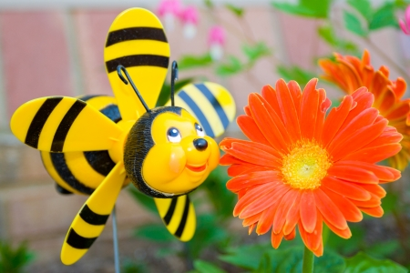 Cheerful garden bee and a flower  photo