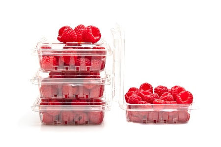 produces: Red raspberries in plastic fruit containers Stock Photo