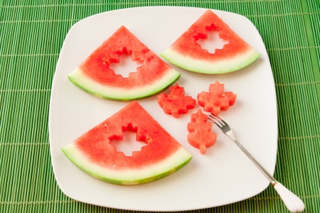 leaf cutter: Seedless watermelon slices cut with leaf shape cutter for kids fun meal