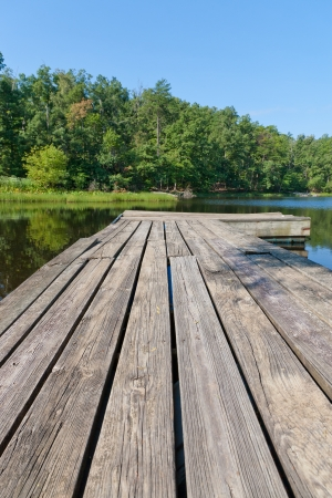 Old wooden pier on small local lake.