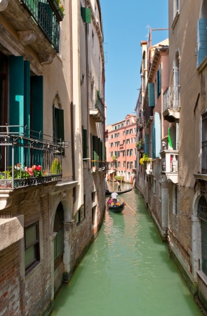 View of a narrow canal in Venice, Italy photo