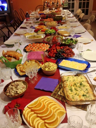 New year celebration with traditional Russian feast at big table.