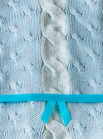 Blue and white knitting wool texture background with ribbon photo