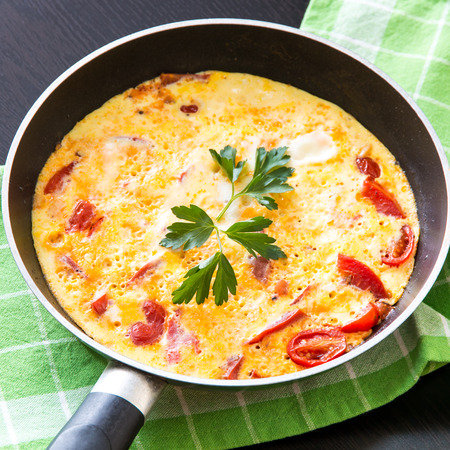 Scrambled eggs with  tomatoes, hot breakfast  selective focus Reklamní fotografie