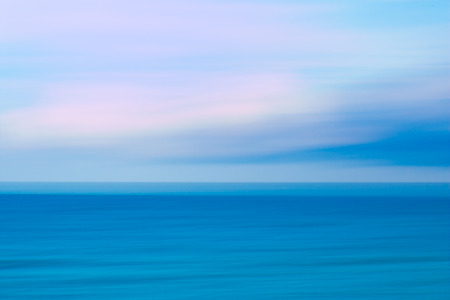 panning: Abstract sky and  ocean nature background with blurred panning motion.