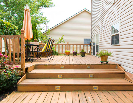 Patio and garden of family home at summer Standard-Bild