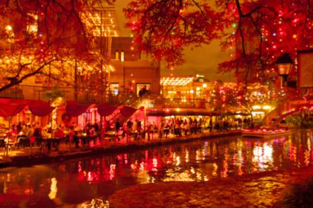 Blurred holiday background. River walk  in San Antonio city at night in Christmas season, Texas, USA Stock Photo