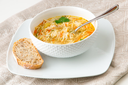 Bowl of chicken noodle soup Stock Photo