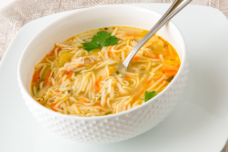 meat dish: Bowl of chicken noodle soup Stock Photo