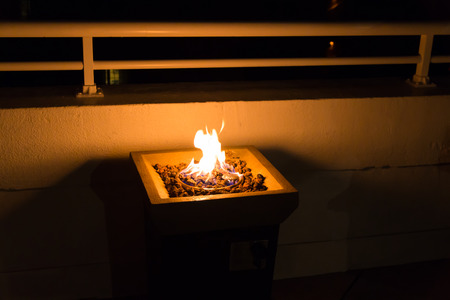 Fire pit on roof terrace for marshmallows and smores roast.