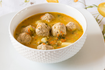 soups: Soup with turkey meatballs, potatoes and vegetables. selective focus Stock Photo