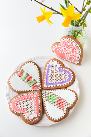 shaped: Home-baked and decorated heart shaped cookies on a plate.