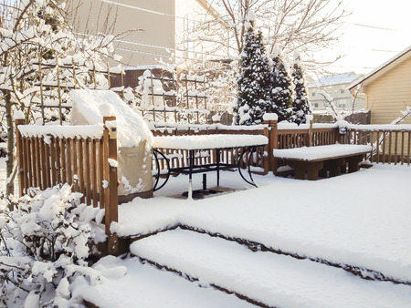 Garden patio after snowfall, winter scenery.