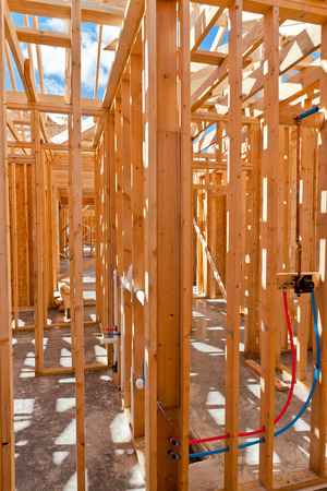 residential construction: An interior view of a new home under construction with exposed wiring