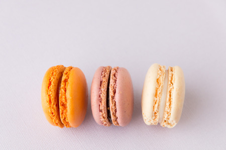 Close up of french sweet delicacy, macaroons colorful  variety. Selective focus, shallow dof. Stock Photo