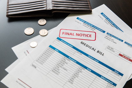medical notes: Medical bill from the hospital, concept of rising medical cost, selective focus.  All data on the bill and form design are fictional, created specially for this concept. Stock Photo