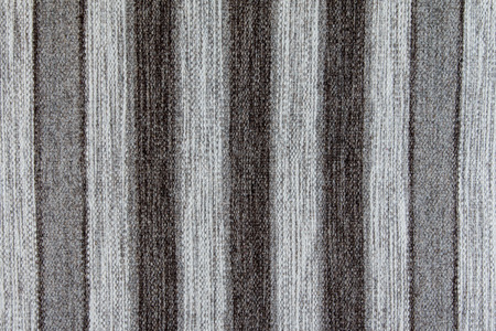 rug texture: Wool rustic rug with gray, white and black stripes, texture background.