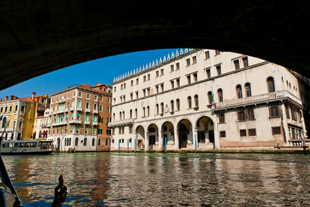 rialto: A view from gondola ride under Rialto bridge on the canals of Venice in Italy