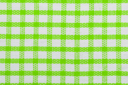 Green checked fabric background, kitchen towel texture.