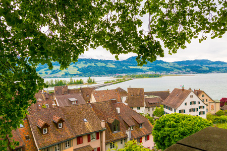 View of Rapperswil red tile roofs and Zurich lake. Rapperswil, Switzerland.