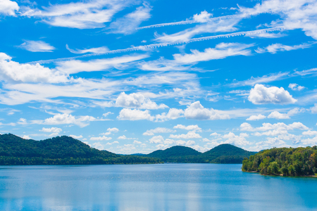 Summer view of local lake Cave Run with beautiful forest on lake hillside shore and dramatic cloudscape sky in Kentucky, USA Stock Photo