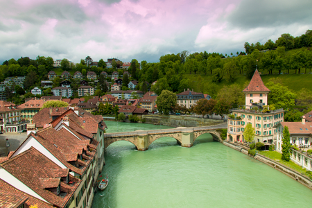 Old city of Bern, Switzerland  with river Aare on overcast day.