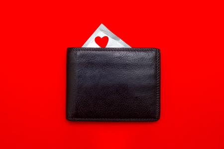 a condom in a wallet. safe sex concept Foto de archivo
