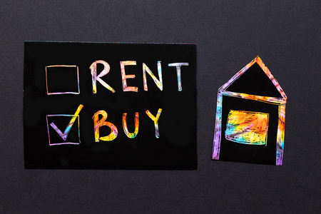 rent or buy concept. a colorful text with checkboxes Фото со стока