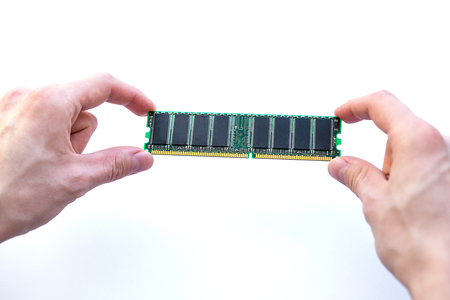 male hands holding ram memory card on a white background