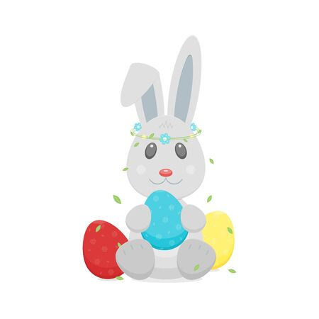 Easter eggs, bunny rabbit with wreath on head.