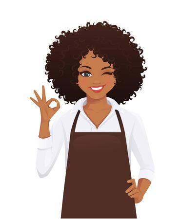 Femme souriante en tablier avec une coiffure afro gesticulant signe ok illustration vectorielle isolée