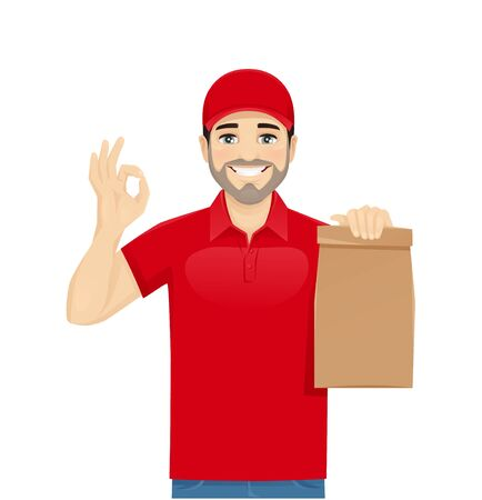 Handsome delivery man in red uniform gesturing ok sign with paper packet isolated vector illustration