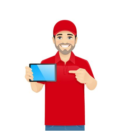 Handsome delivery man in red uniform showing tablet witn blank screen. Isolated vector illustration Ilustração
