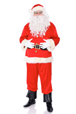 Santa Claus standing isolated on white background. Full length portrait. Stock Photo