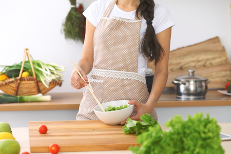 Woman cooking in the kitchen. Close-up of hands. Concept of healthy meal or tasty breakfast Stock Photo