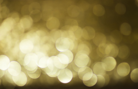 conception: Blurred lights with bokeh effect golden Background. Soft and blur conception